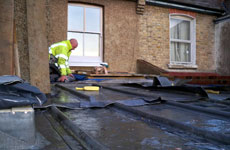 Picture of Roofing Contractor doing repairs
